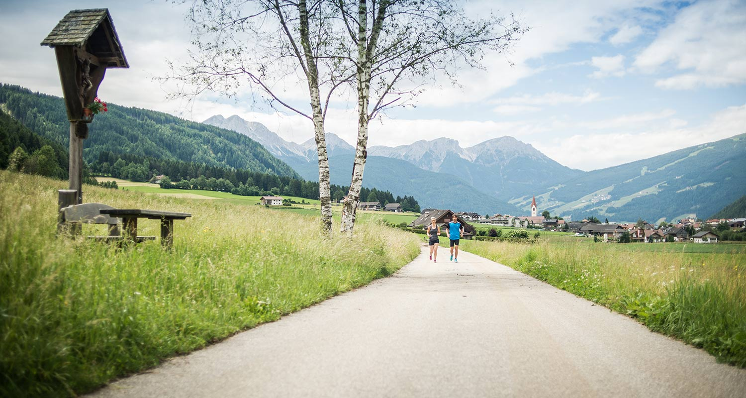 Couple walking along the country road towards Rasen Antholz