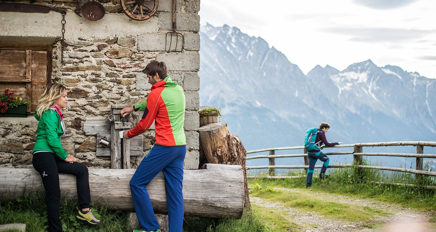 Group of hikers at a hut having a break