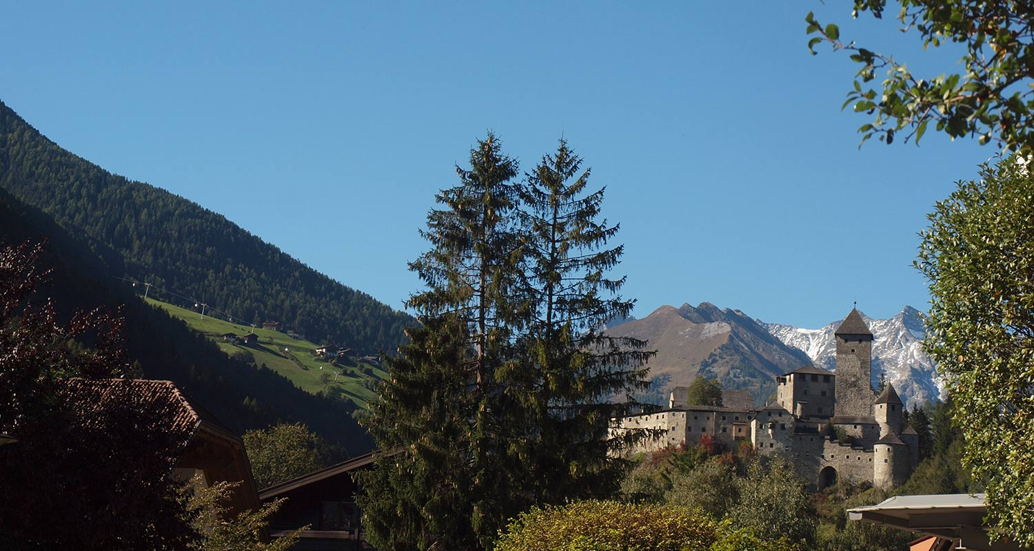 View of Antholz Castle in Kronplatz area on a summer day