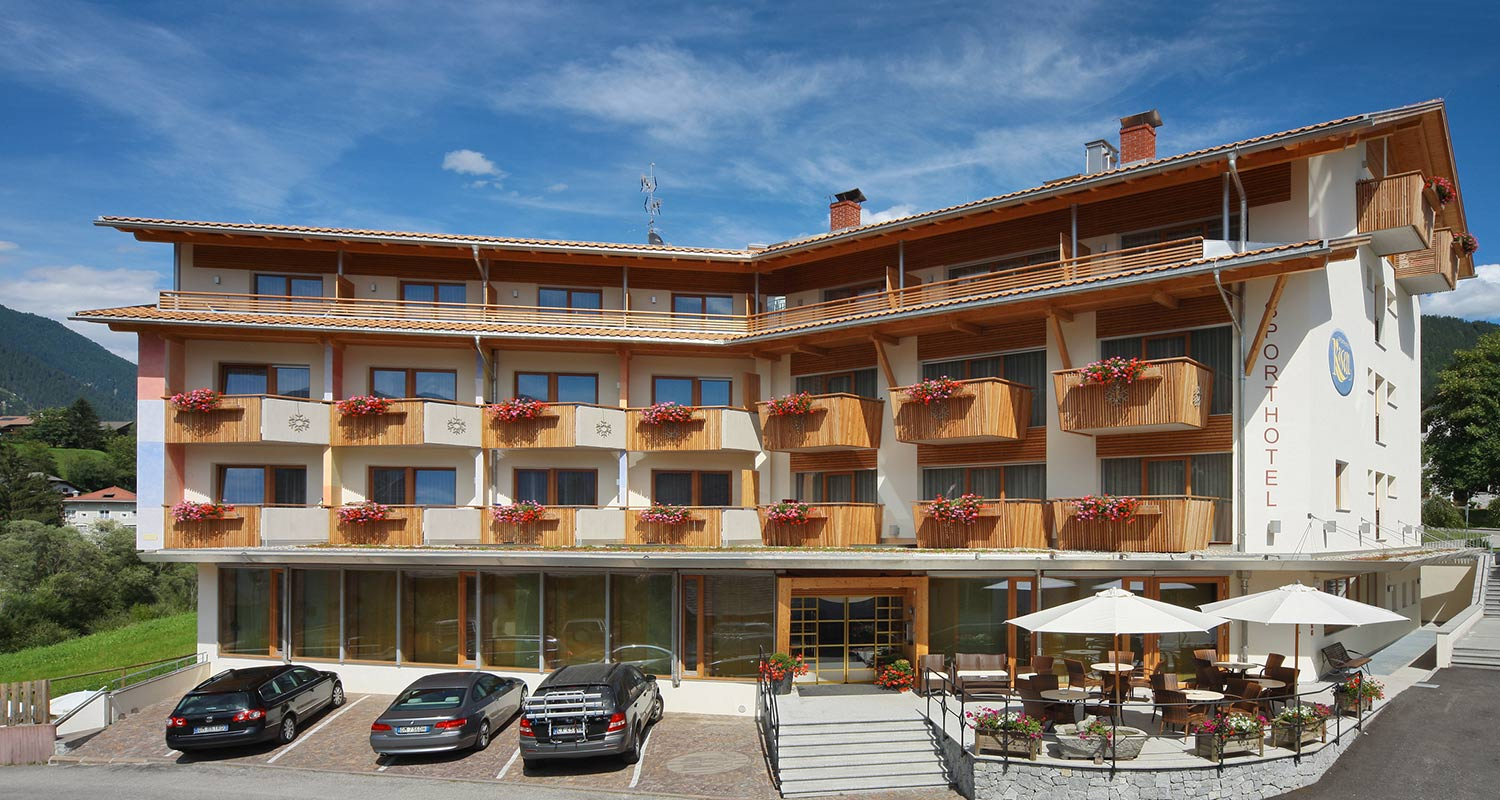 Exterior view of Sporthotel Rasen in Antholz on a beautiful summer day