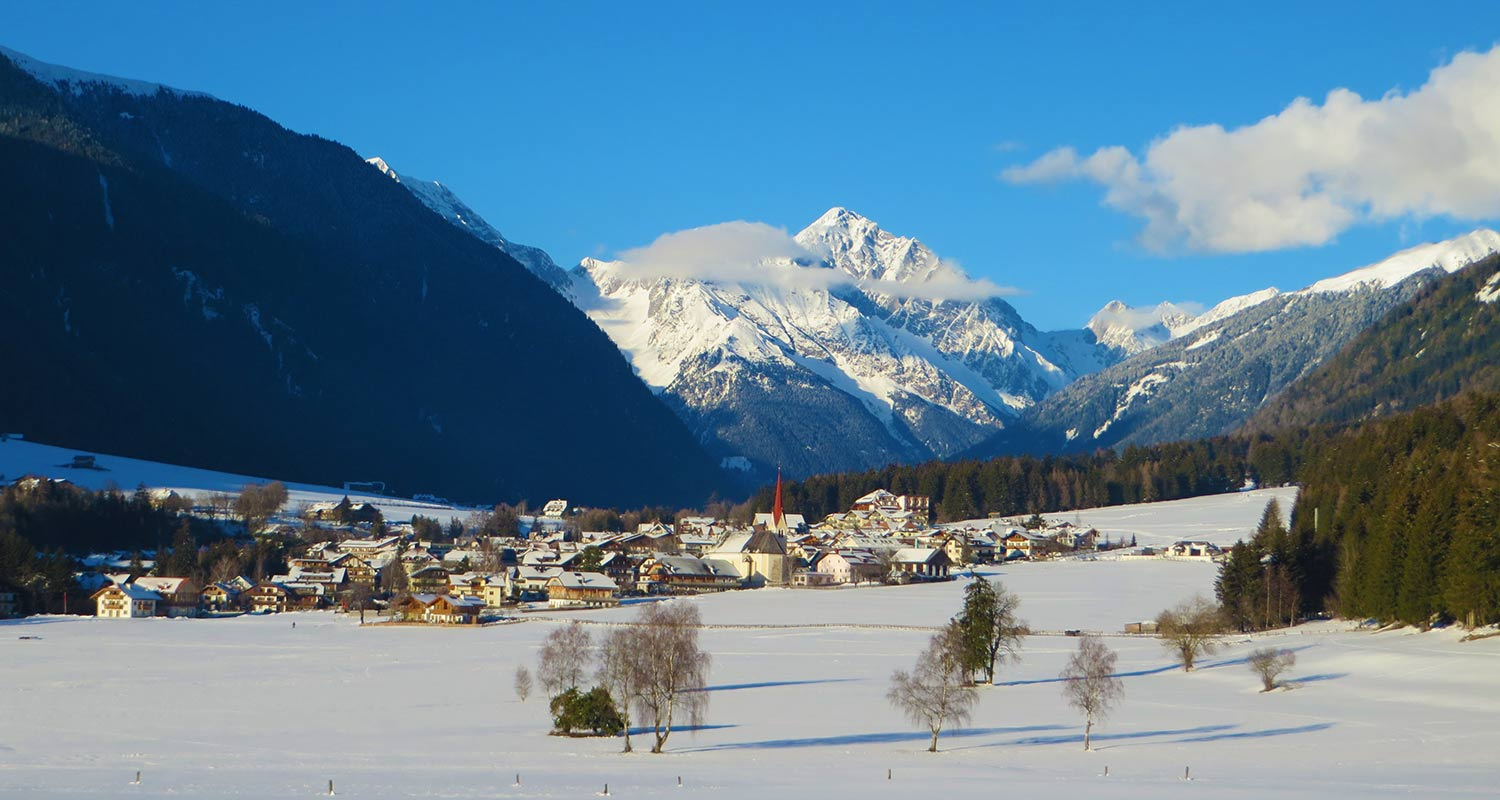 The village Rasen in Antholzertal surrounded by snowy landscape